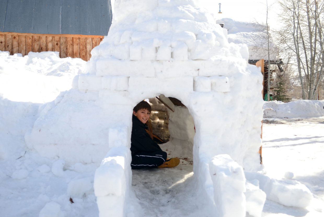 Max, pictured, and Gibby Kenney spent the last few days building their first snow fort. Constructed using a snow fort kit Max got for his birthday in December, the brothers spent hours during the weekend building ice bricks to make the igloo come to life. On Sunday night, they even built a fire inside, which blew smoke out of the igloo's specially designed chimney.
