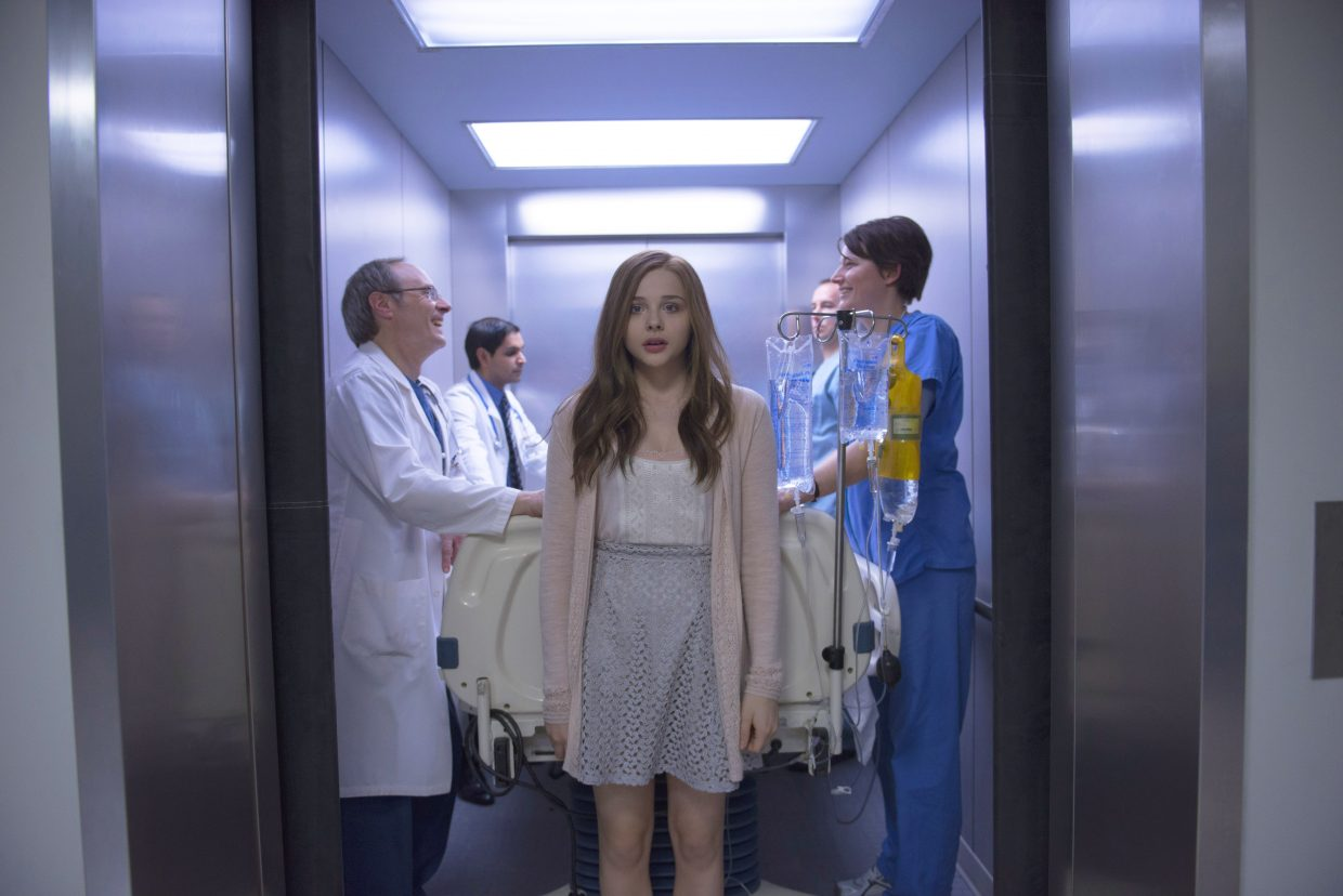 """Mia (Chloë Grace Moretz) is forced to accompany a group of doctors to surgery in """"If I Stay."""" The movie is about a teenage cellist who has an out-of-body experience after a car wreck and must choose if she wants to live."""