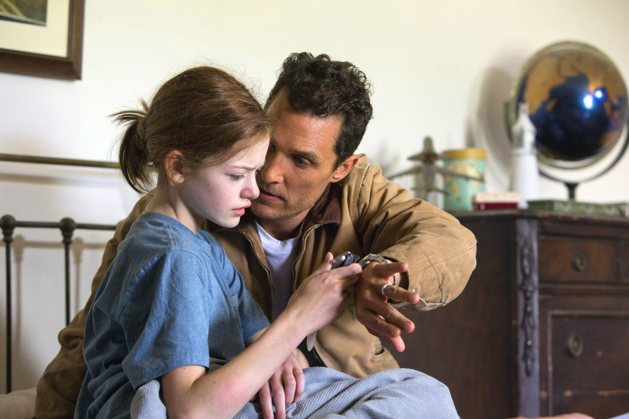"""Cooper (Matthew McConaughey) says an emotional farewell to his daughter, Murphy (Mackenzie Foy), in """"Interstellar."""" The movie is about a former pilot brought back into service to fly a space mission and possibly save a dying Earth in the near future."""