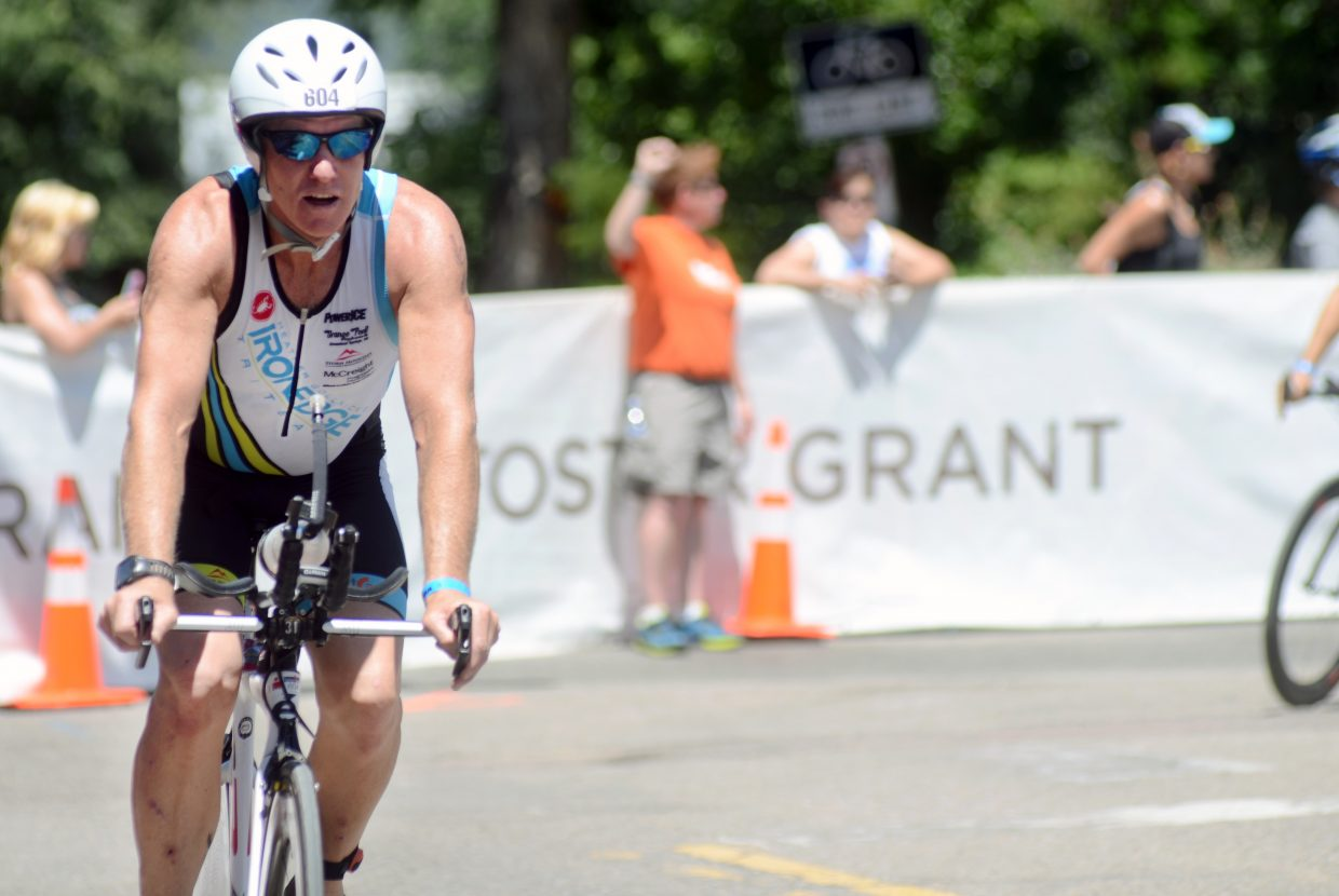 Steamboat's Mike Schlichtman rounds the corner into the transition zone between the 112-mile bike portion into the marathon at Sunday's Boulder Ironman. Schlichtman was the first of Steamboat's six athletes to make it to the final transition zone.