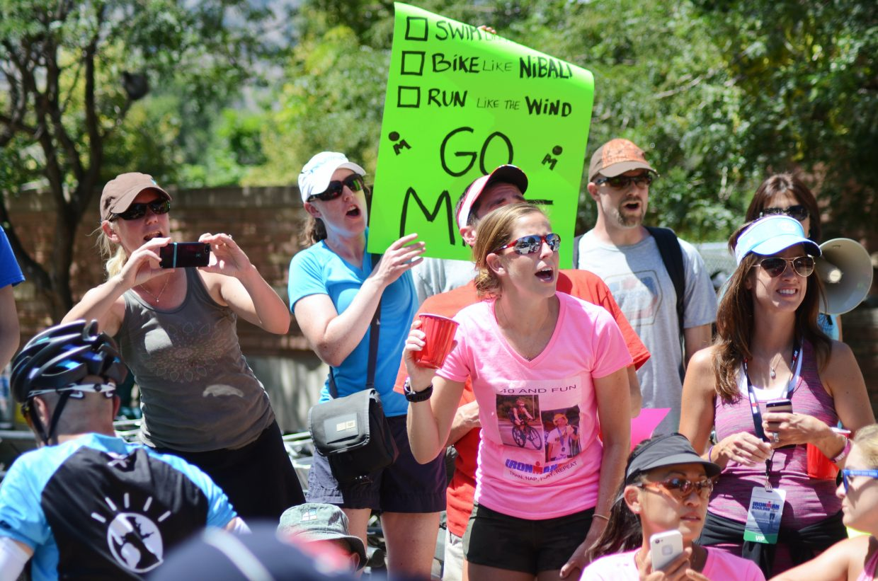 Thousands of fans flocked to the curbs and streets Sunday at the Boulder Ironman, especially the transition zones as cyclists turned a 112-mile bike ride into a full marathon.