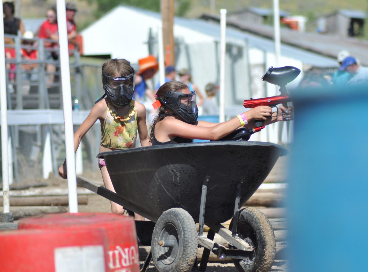 Isabel Mathey pushes Jayden Black through the youth Paintball Obstacle Course at the 2014 Routt County RedneX Games in Hayden, Colorado. Submitted by: Wendy Lind