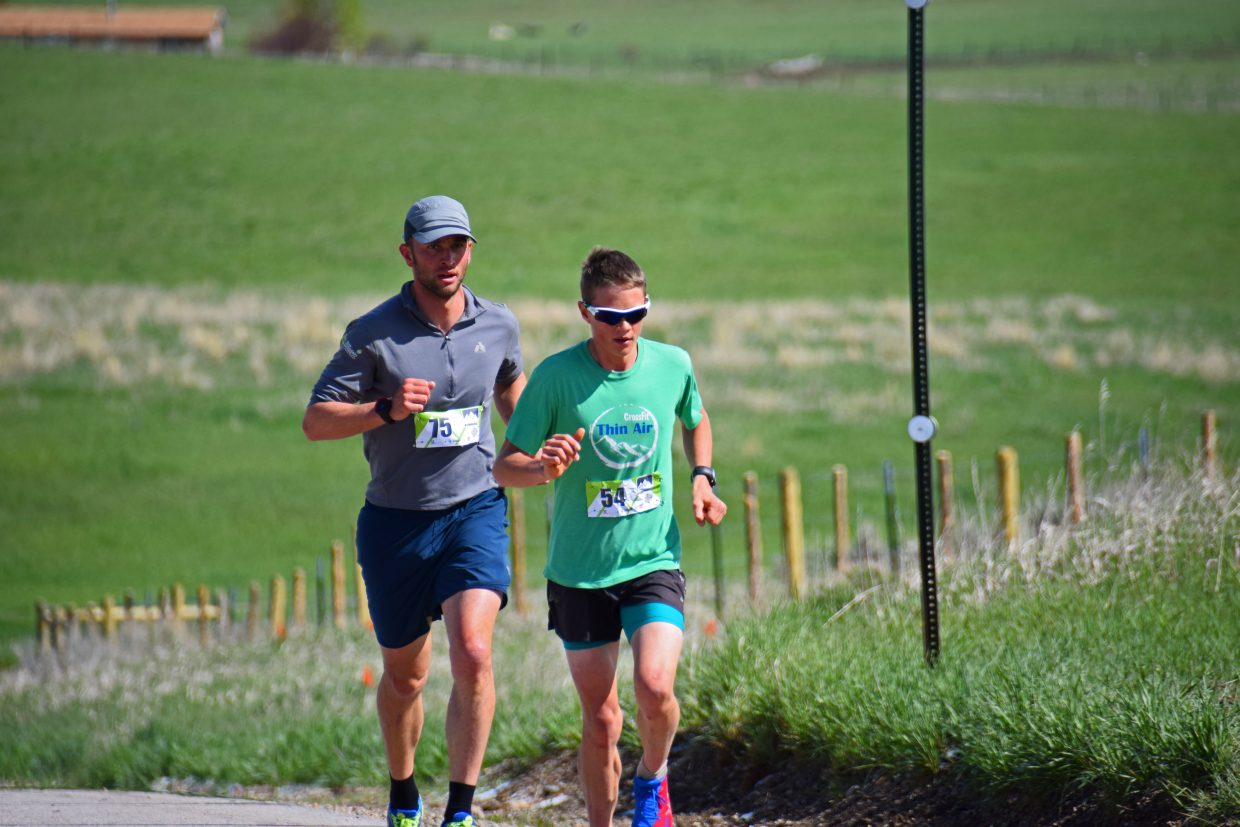 Jashua Smullin (75) and Simon Zink (54) lead the 2015 Cog Run 5k held on Saturday in Hayden. Joshua finished in 2nd place with a time of 18 minutes, 36 seconds. Submitted by David Torgler.