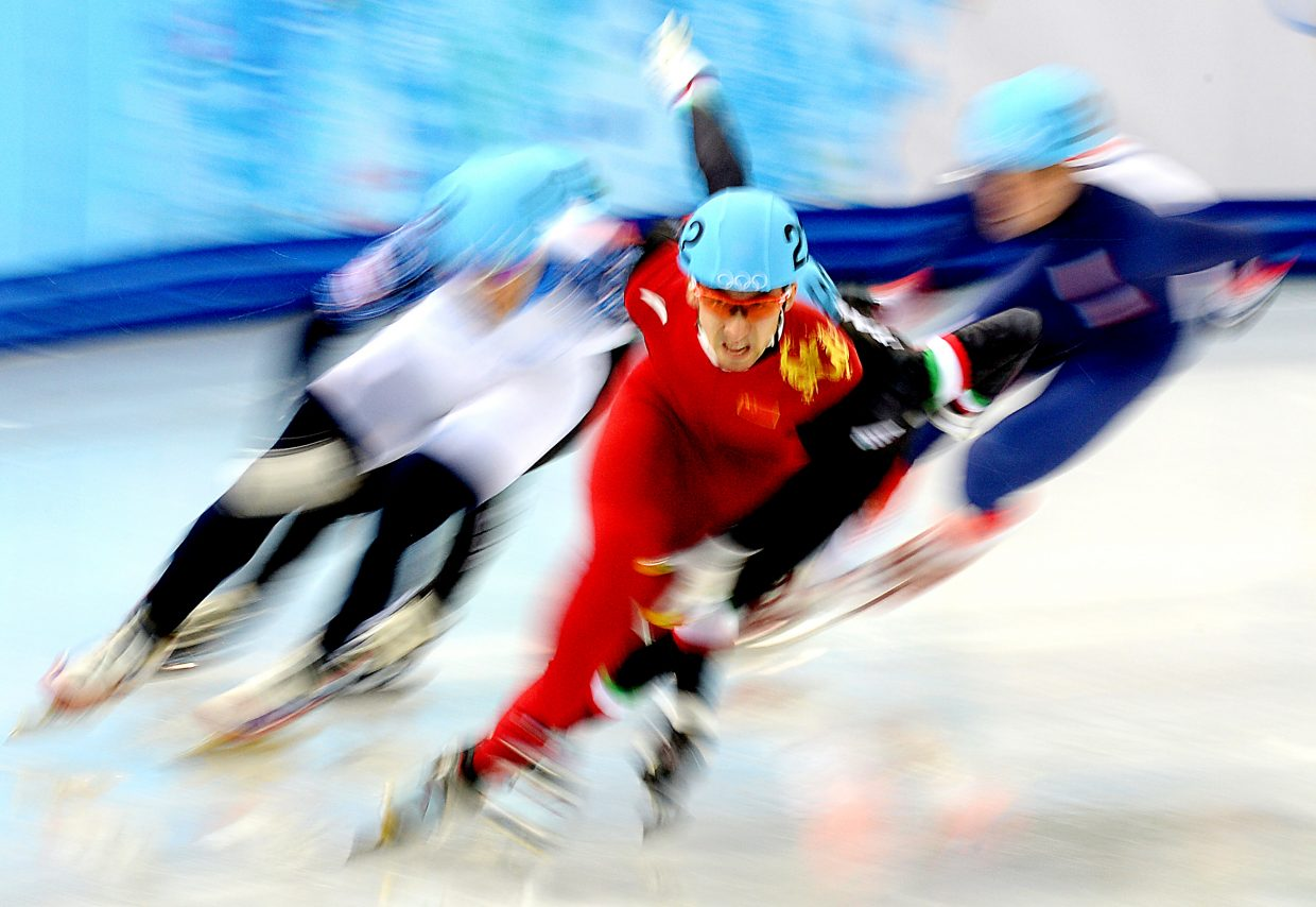 Chinese skater Dajing Wu leading the pack in the men's 1,000-meter quarterfinals at the 2014 Winter Olympics.