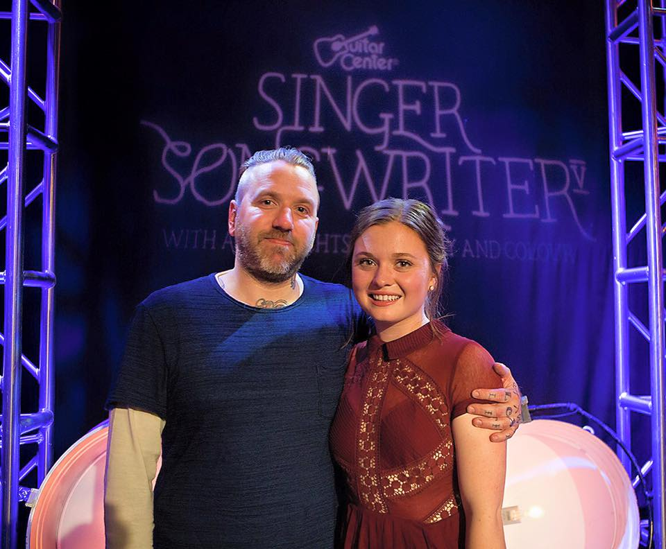 Local singer songwriter, Kate Brady (Katie Ross) stands with Dallas Green from City and Colour. Last week she was chosen by Grammy award-winning producer Ariel Rechtshaid, who has worked with Usher, Diplo, Vampire Weekend, HAIM and more, as the Guitar Center Singer Songwriter 5 Competition winner.