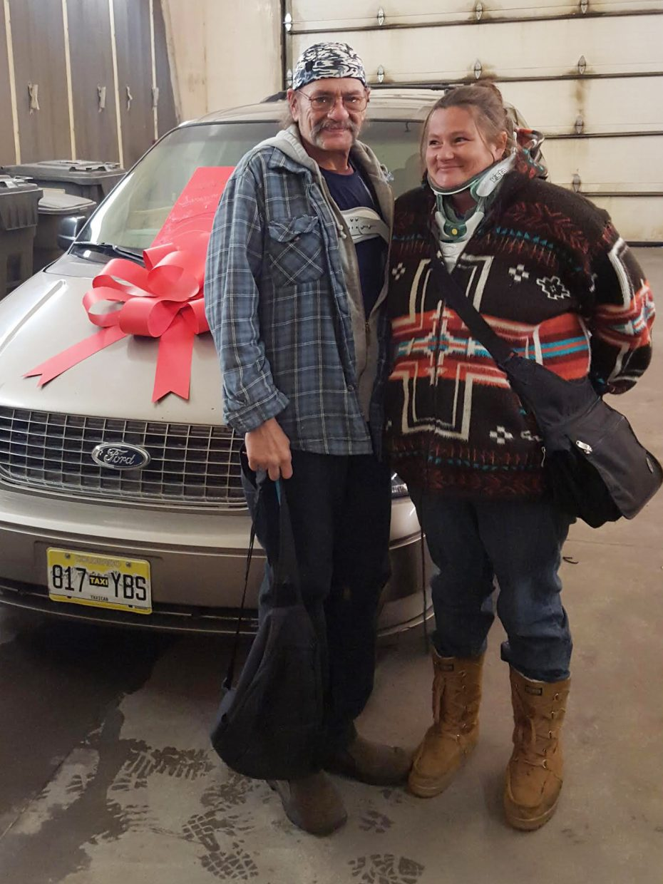 Yampa's Lary King, left, and his wife, Marti, stand next to a vehicle lent to them by Go Alpine earlier this month. The generous act was in response to the family's recent struggles, which included the death of one of their sons to a rare degenerative brain disease and two separate car crashes, all within the span of a couple of months. The Kings had been without a working vehicle until Go Alpine stepped in to help them out.