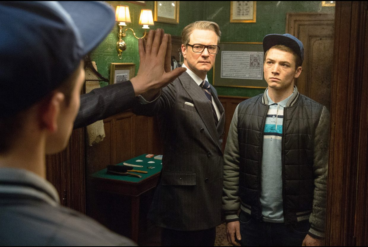 "Secret agent Harry Hart (Colin Firth) prepares to show his young student Eggsy (Taron Egerton) what kind of benefits his career could have in ""Kingsman: The Secret Service."" The movie is about a group of British spies, whose newest recruit must help stop the workings of a wealthy madman."