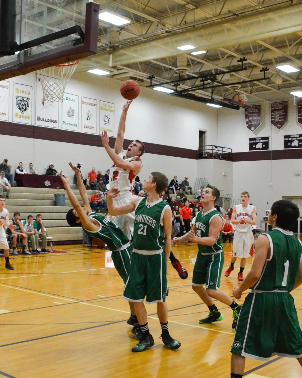 Nathan DePuy drives to the basket for two and gets the foul during Steamboat Springs' game against Delta in the Western Slope tournament. Steamboat won, 45-27.