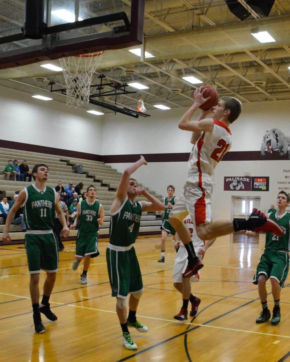 Matthew Lanning flies high for two during Steamboat Springs' game against Delta in the Western Slope tournament. Steamboat won, 45-27.