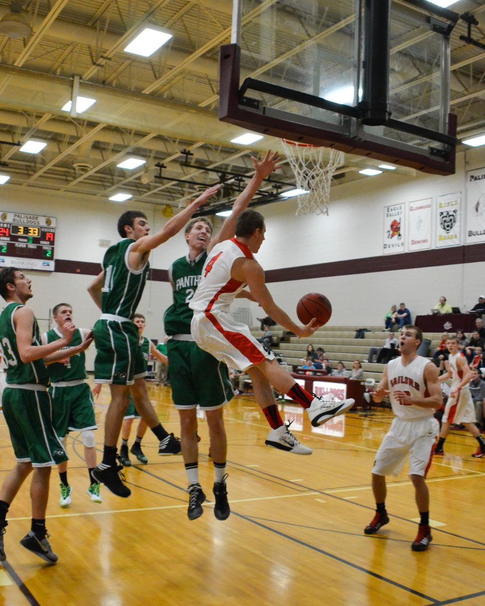 A nice assist from Mitch McCannon helps Nathan DePuy score two during Steamboat Springs' game against Delta in the Western Slope tournament. Steamboat won, 45-27.