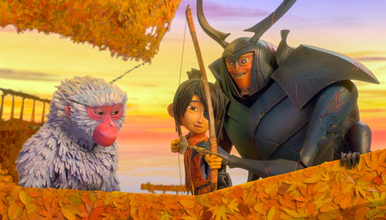"""Kubo (Art Parkinson) is taught to handle a bow by guardians Monkey and Beetle (Charlize Theron, Matthew McConaughey) in """"Kubo and the Two Strings."""""""