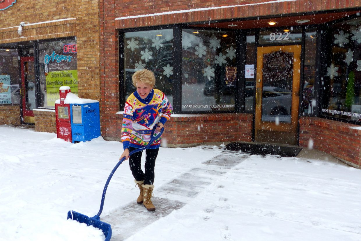 Jenny Wall shovels the sidewalk in front of Moose Mountain Trading Company. Submitted by: Shannon Lukens