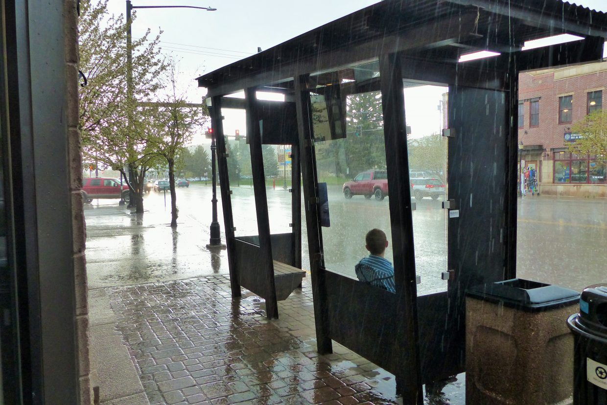 This young man was sheltered by the bus stop, during a downpour downtown this evening. This picture was taken on Lincoln Avenue in downtown Steamboat Springs. Submitted by Shannon Lukens.