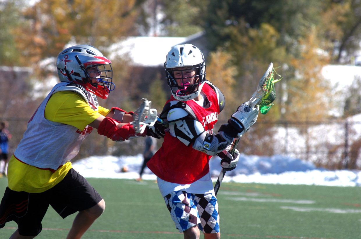 Steamboat Springs Middle School student Tyler Doyne, left, checks Cooper Jones during the second annual Steamboat Chumash Challenge on Sunday morning at Gardner Field.