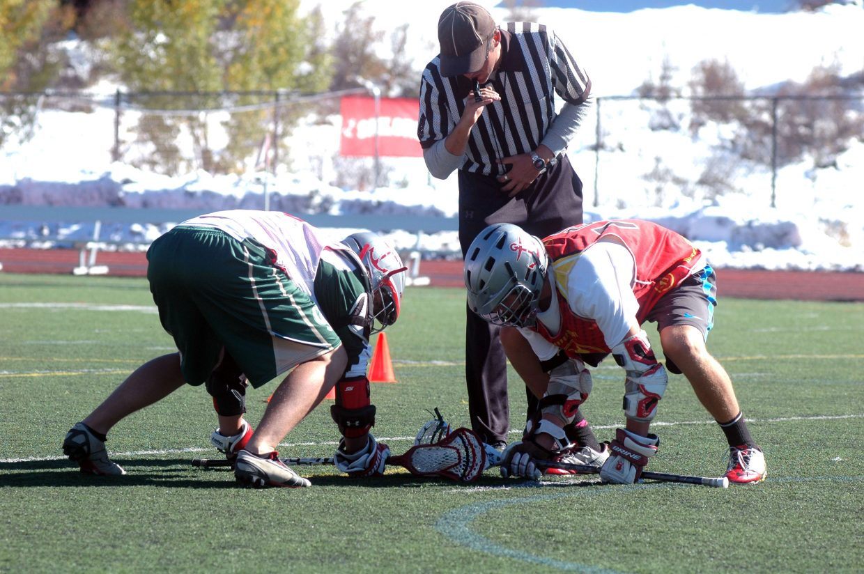 Steamboat Springs High School lacrosse players Joe DeLine, left, and senior Ben Wharton compete in a faceoff Sunday afternoon during the Steamboat Chumash Challenge.