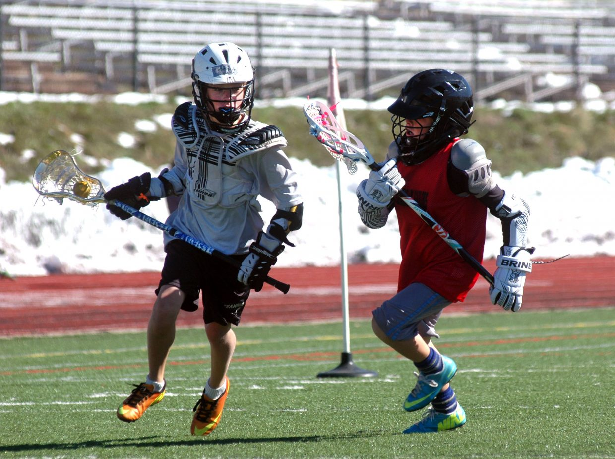 Cooper Puckett, left, turns the corner on a defender Sunday morning during the second annual Steamboat Chumash Challenge.