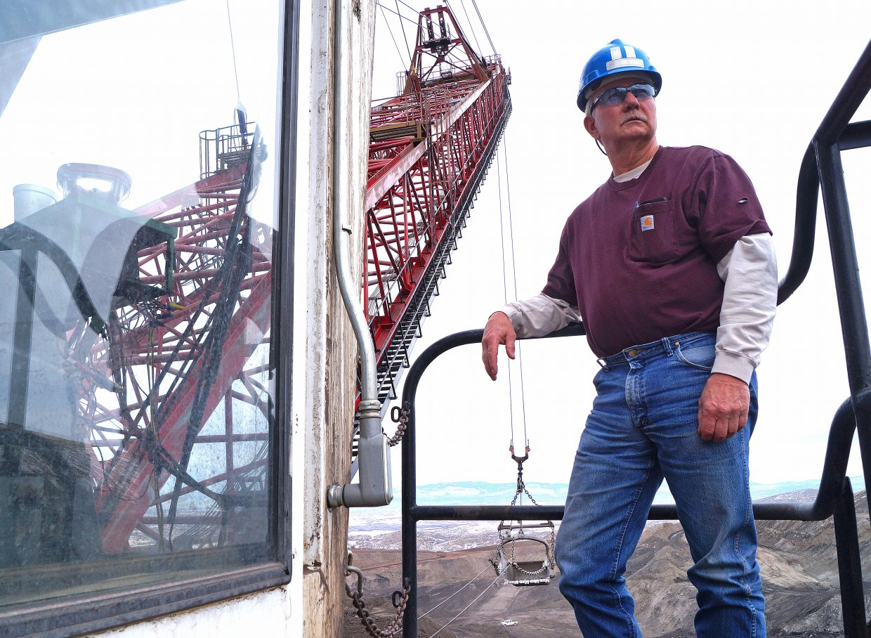 Mike Kuberry, a 37-year Trapper veteran and current dragline operator, on the top of his excavator, Molly Brown.