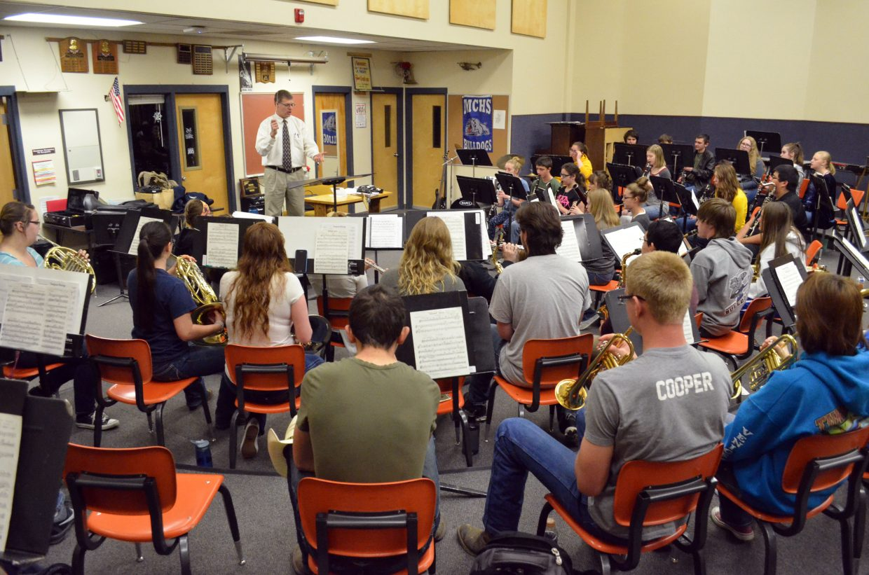 John Bolton directs the members of the Moffat County High School concert band during a practice session. The act of bringing together a large group to create something as one is music's entire purpose, Bolton said.