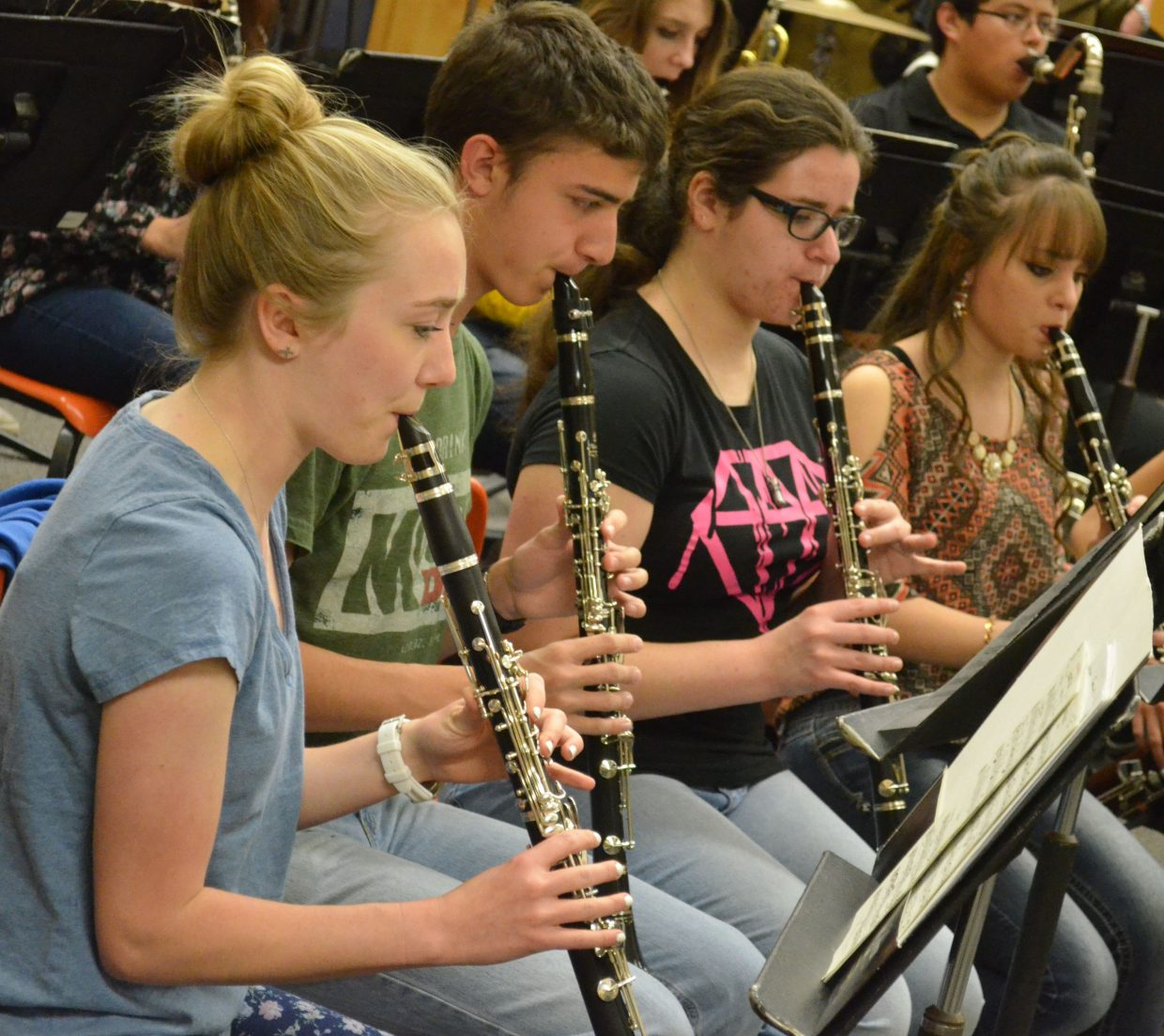 The members of the clarinet section and other woodwinds of the Moffat County High School concert band work to stay in sync.
