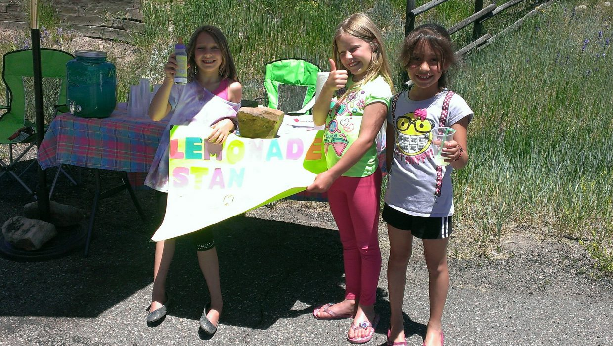 Lily, Kaelyn, and Itzia selling lemonade for charity on a hot Sunday afternoon. Submitted by: Russell Frinks