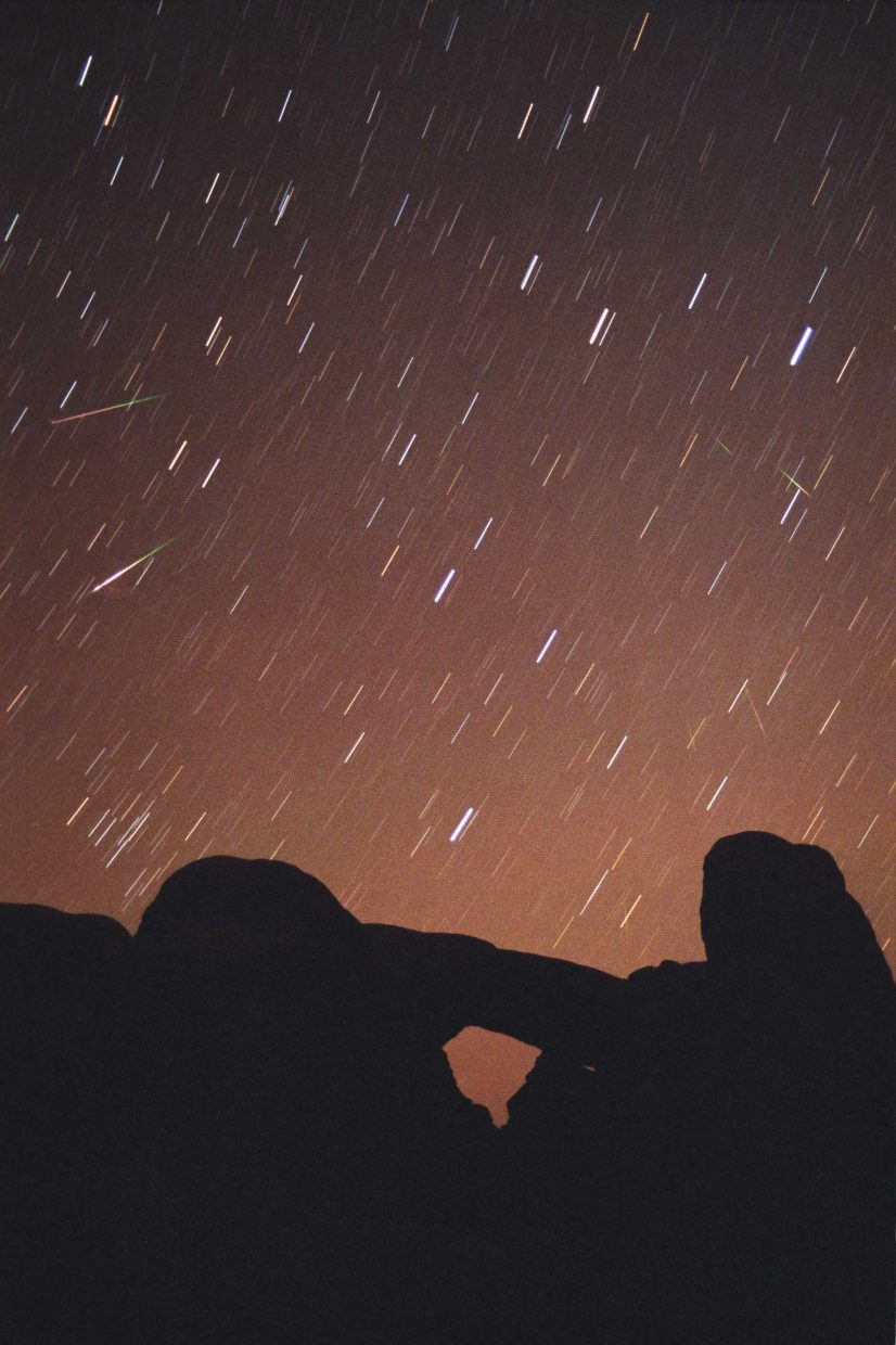 The surprise celestial event of 2014 might be a strong shower of meteors on May 24 caused by bits of dust from Comet 209P/LINEAR. Earth encountered a similar dust swarm from Comet 55P/Tempel-Tuttle in 2001 and experienced a meteor storm of more than 1,000 meteors per hour, seen here in an image taken from Arches National Park near Moab, Utah. Photo by Jimmy Westlake.