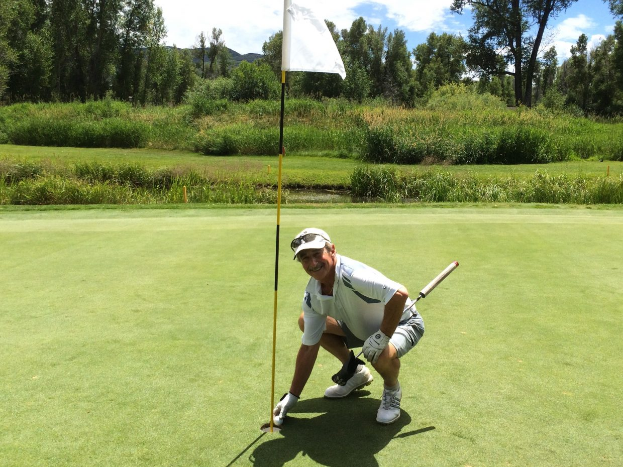 Rich Danter retrieving his Hole in One ball Sunday 7/26 on the 3rd hole at the Steamboat Golf Club. Submitted by Linda Danter.
