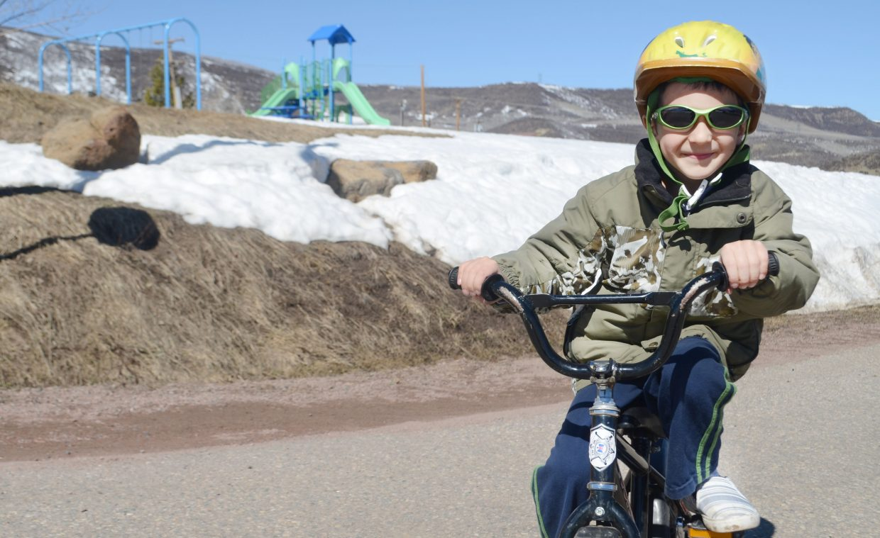 Oak Creek 5-year-old Steven Tzerovski rides his bike by Sierra View's children's park Saturday morning. Grants from LiveWell Northwest Colorado and matching grants from other organizations have helped revamp the town's recreational profile.
