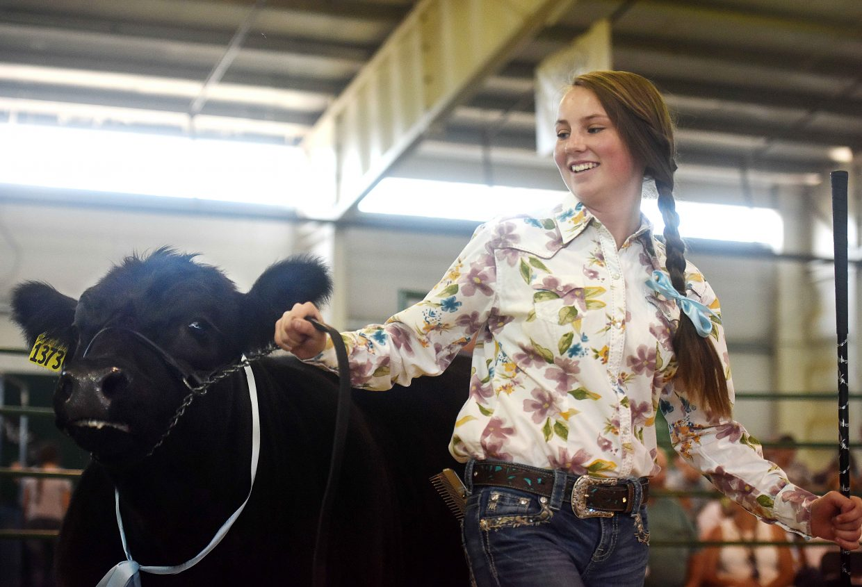 Amber Townsend, 15, shows off her steer, Bruno, — like Bruno Mars, she said — around the pen Saturday at the Routt County Fair Junior Livestock sale in Hayden.