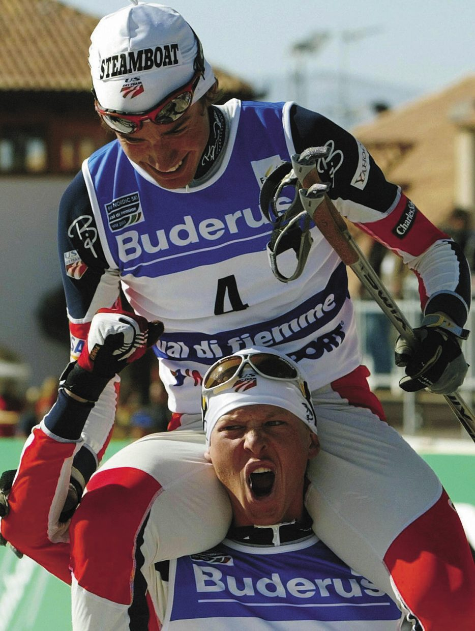 Lodwick pumps his fist and carries teammate Johnny Spillane on his shoulders after Spillane won a World Championship in 2003.