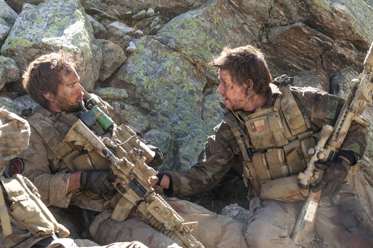 """Navy SEALs Michael P. Murphy (Taylor Kitsch) and Marcus Luttrell (Mark Wahlberg) try to formulate a plan while under fire in """"Lone Survivor."""" The movie is about Navy SEAL Team 10's failed 2005 mission to capture and kill a Taliban leader in Afghanistan."""