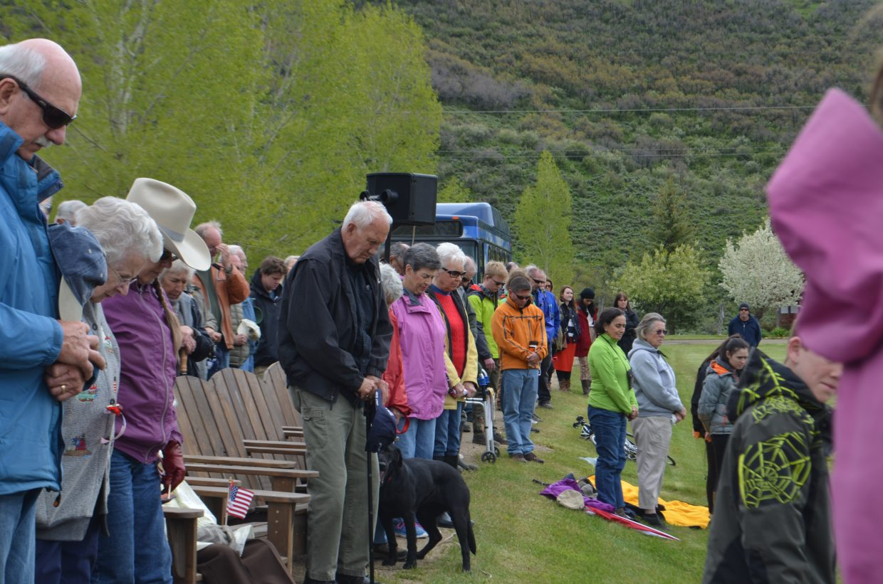Community members gather for a moment of silence Monday morning at the Memorial Day celebration at Steamboat Springs Cemetery hosted by VFW Post 4264 and American Legion Post 44.