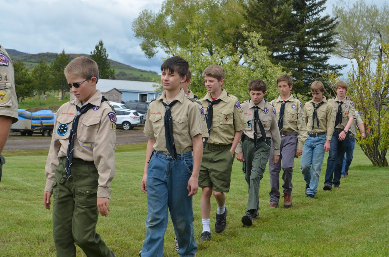 Dan Ragan leads the Steamboat Springs Boy Scouts Troop 194 during Monday's Memorial Day ceremony.