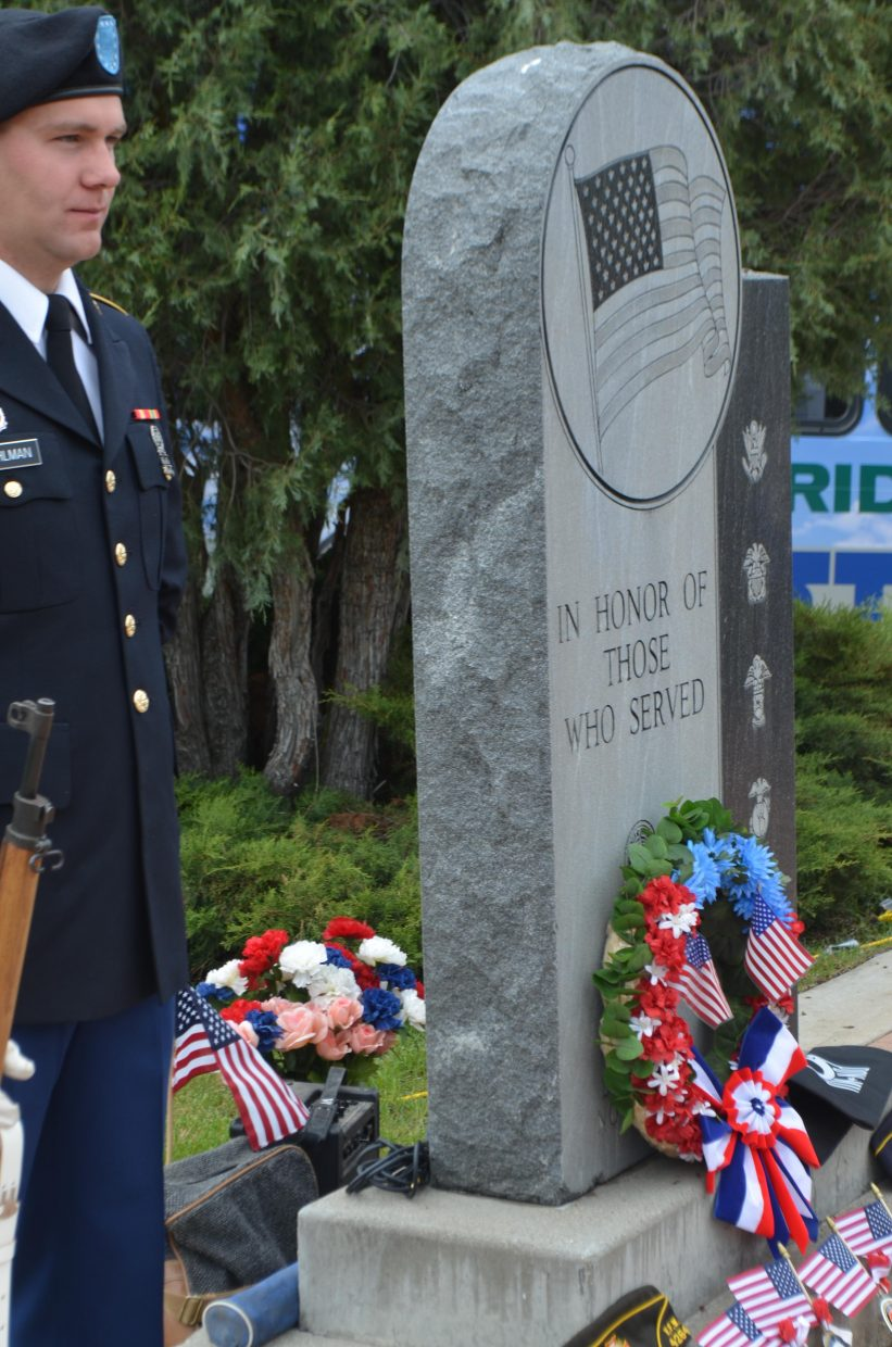 Garrett Pohlman stands at attention during Monday's Memorial Day ceremony at Steamboat Springs Cemetery.