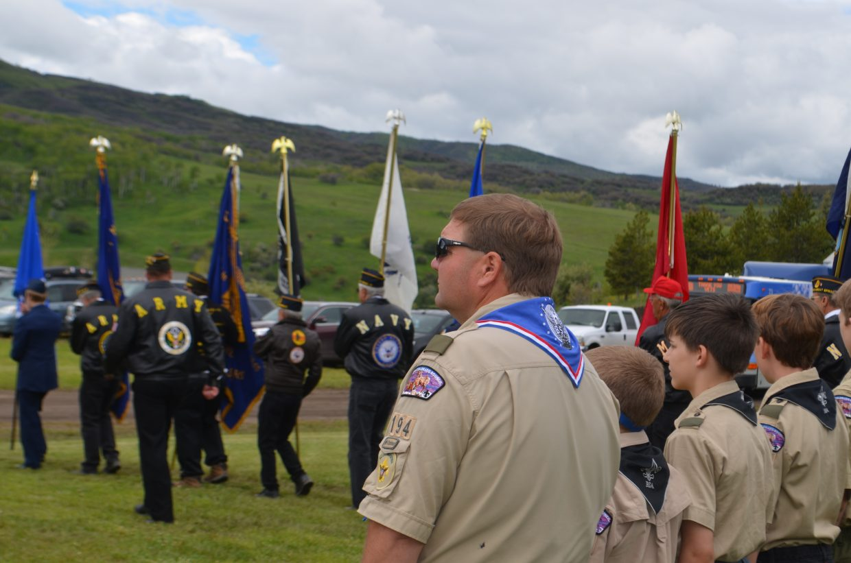 Steamboat Springs Boy Scouts Troop 194 watches the Color Guard closing Monday's Memorial Day celebration.