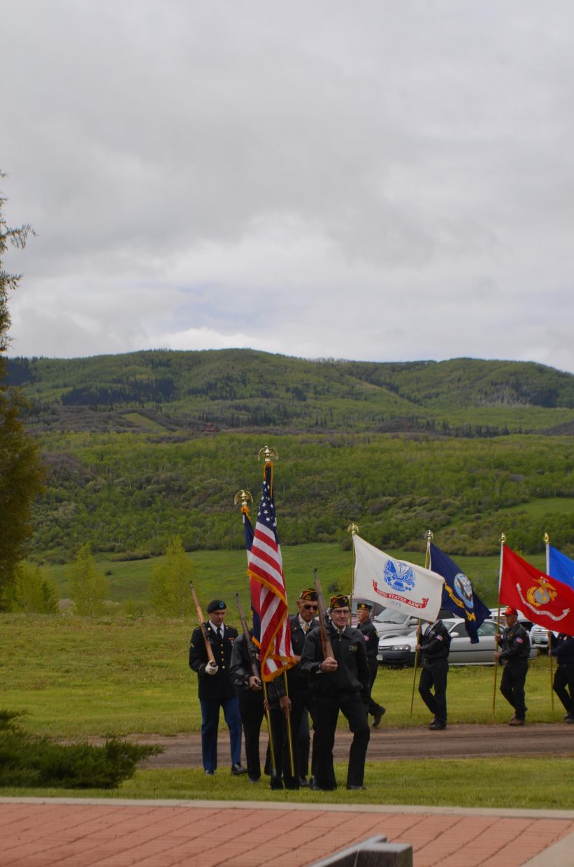 Fred Sandelin and Wayne Weber lead the procession at the beginning of Monday's Memorial Day service in Steamboat Springs.