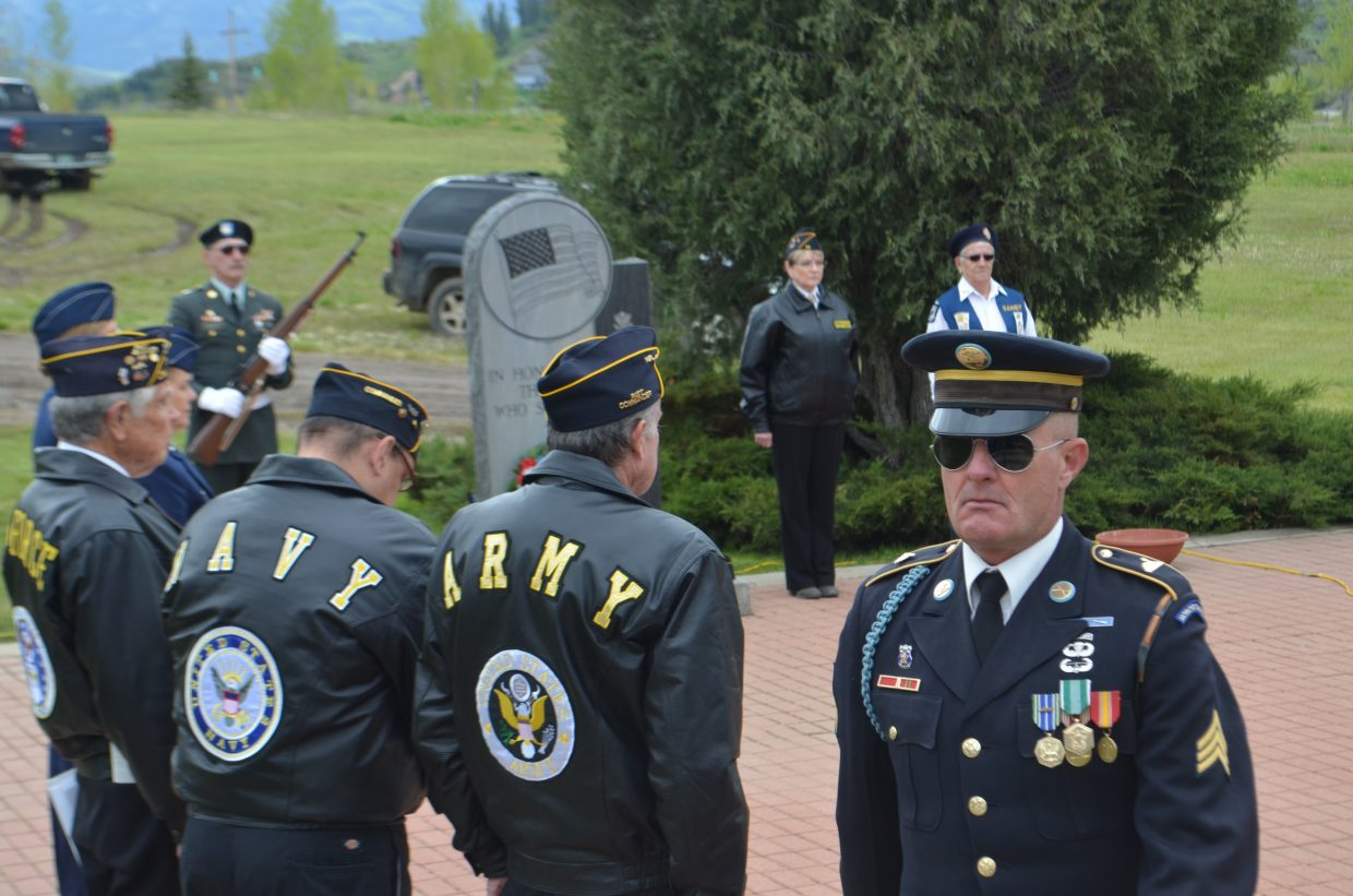 All branches of the military were represented during Monday's Memorial Day ceremony at Steamboat Springs Cemetery, sponsored by veterans of VFW Post 4254 and American Legion Post 44. From left, are Robert Nelson, Loretta Kuhlman, Sandy Herbert, Buck Buckland, Bob Printy and Gaylon Kent. Rick Reinhard is facing the camera.