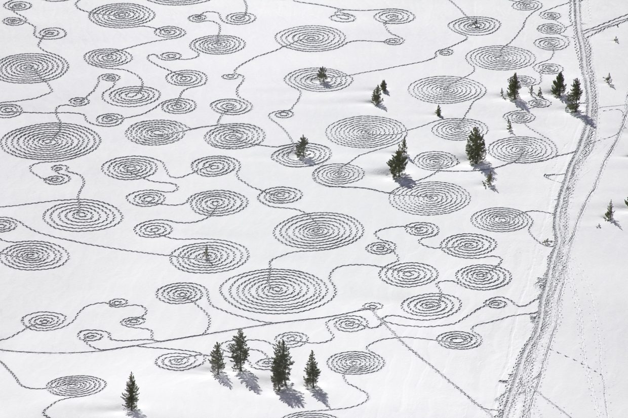 """""""Snow Drawings at Rabbit Ears Pass"""" was created by Sonja Hinrichsen with a group of community volunteers from Steamboat Springs and Hayden on two weekends in January/February 2012 to both sides of the highway."""