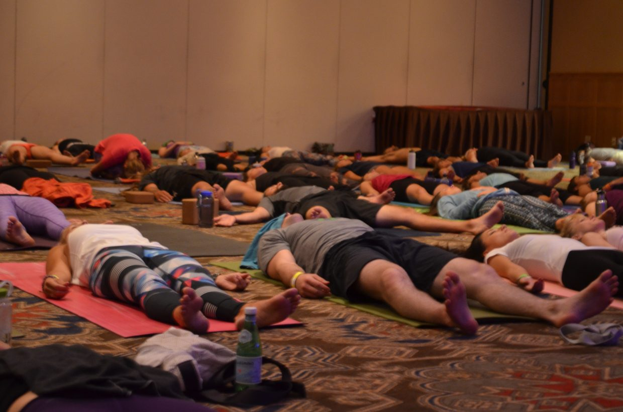 Attendees at the Steamboat Movement Fest lay in Savasana as their body is full relaxed and an awareness of their breath transpires.