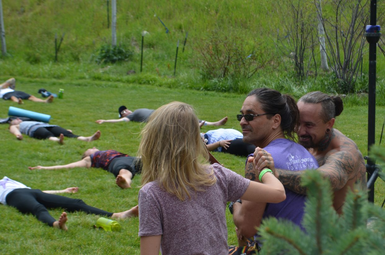 In this photo instructors Justin Kaliszewski and Allie Andrews share a moment of happiness and gratitude at an Earthing Yoga class held Sunday afternoon at the Steamboat Movement Fest.