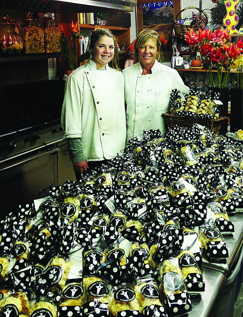 Maureen Totman and her daughter Natasha take a break from their hard work making more than 800 macaroons for this weekend's 18th annual Hollywood Film Awards and American Music Awards in Los Angeles.