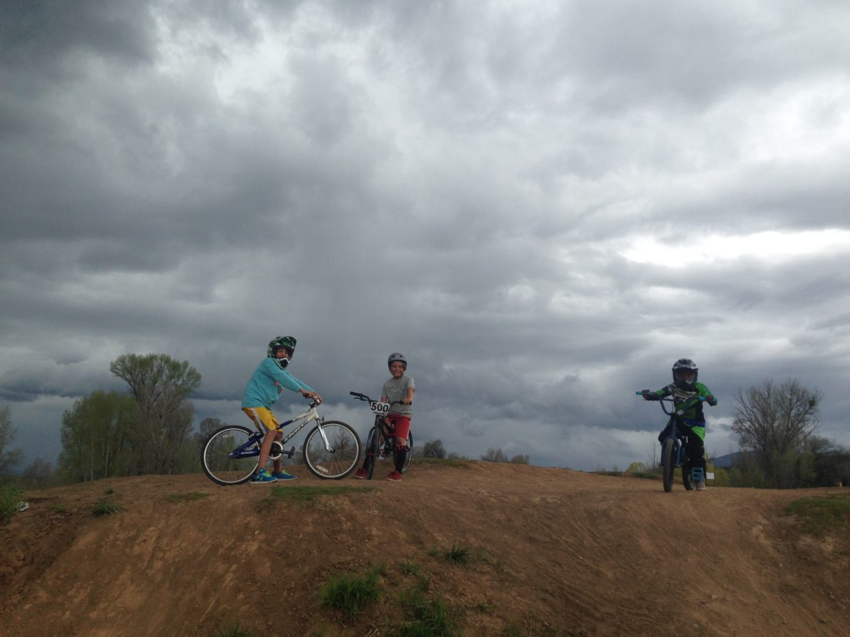 """Catching a few rides between storms: Alex Johnson, Palmer Thompson-LeMay, and Taye Dover."" Submitted by Malaika Thompson."