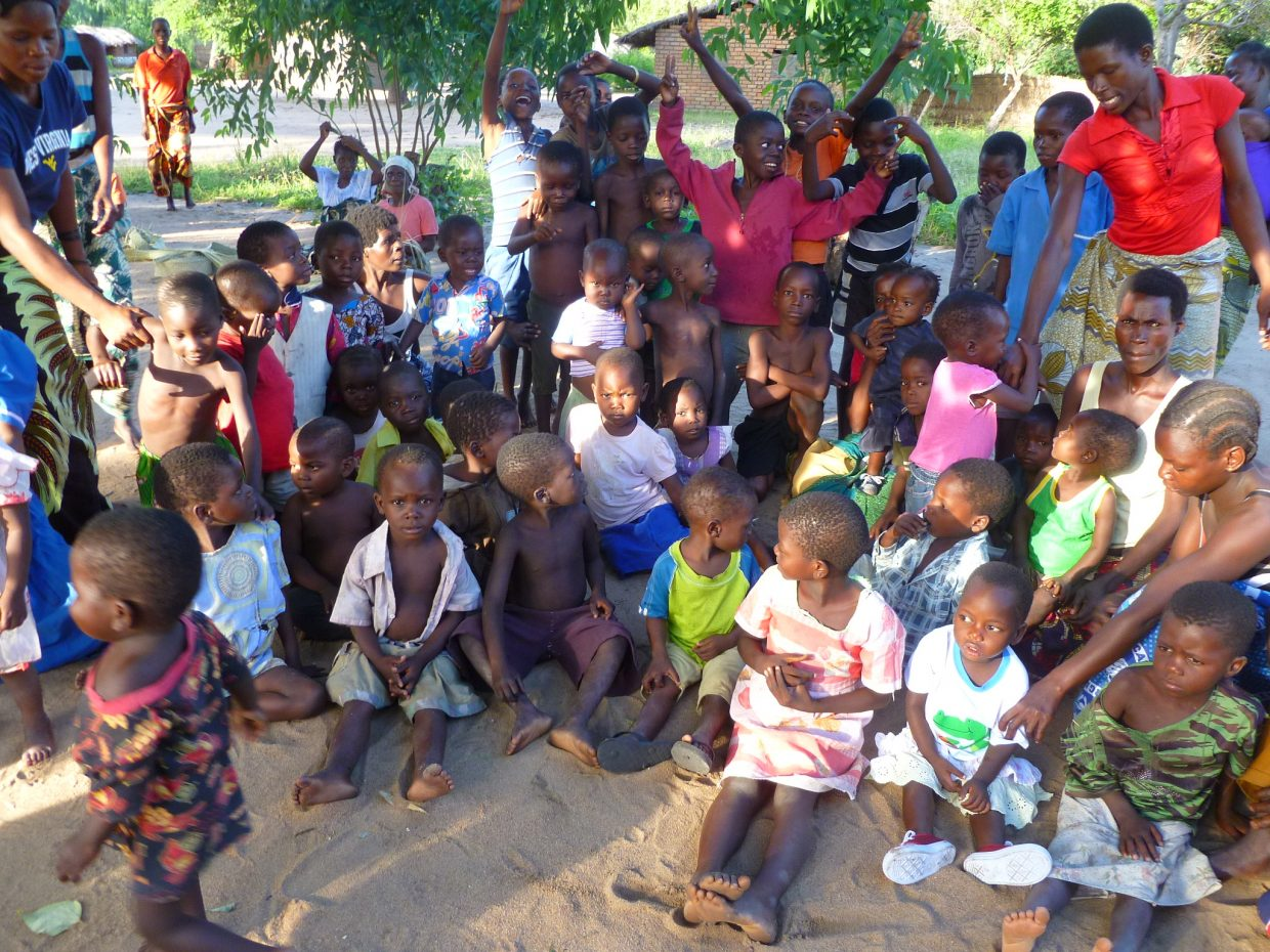 Children gather outside of their newly built school in Malawi.