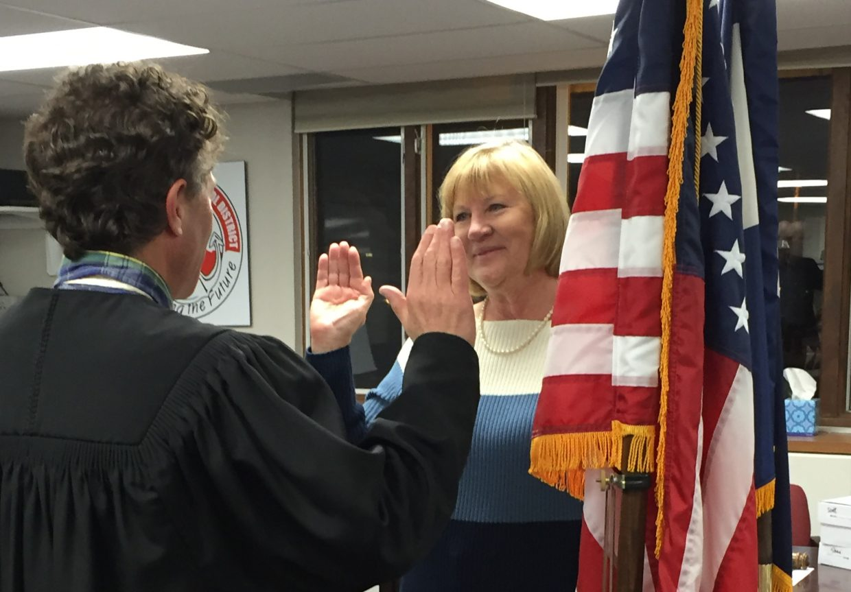 Newly elected Steamboat Springs Board of Education member Margaret Huron is sworn in by Judge Paul Sachs prior to Monday's meeting. Huron was selected later in the meeting as the new board chair.