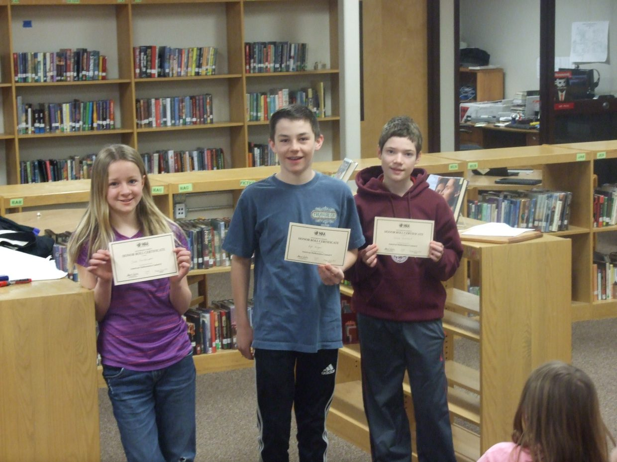 Local students Jade Henderson, Kyle Kagan and Shane Lambert show the awards they won for their performances in the American Mathematics Contest 8.