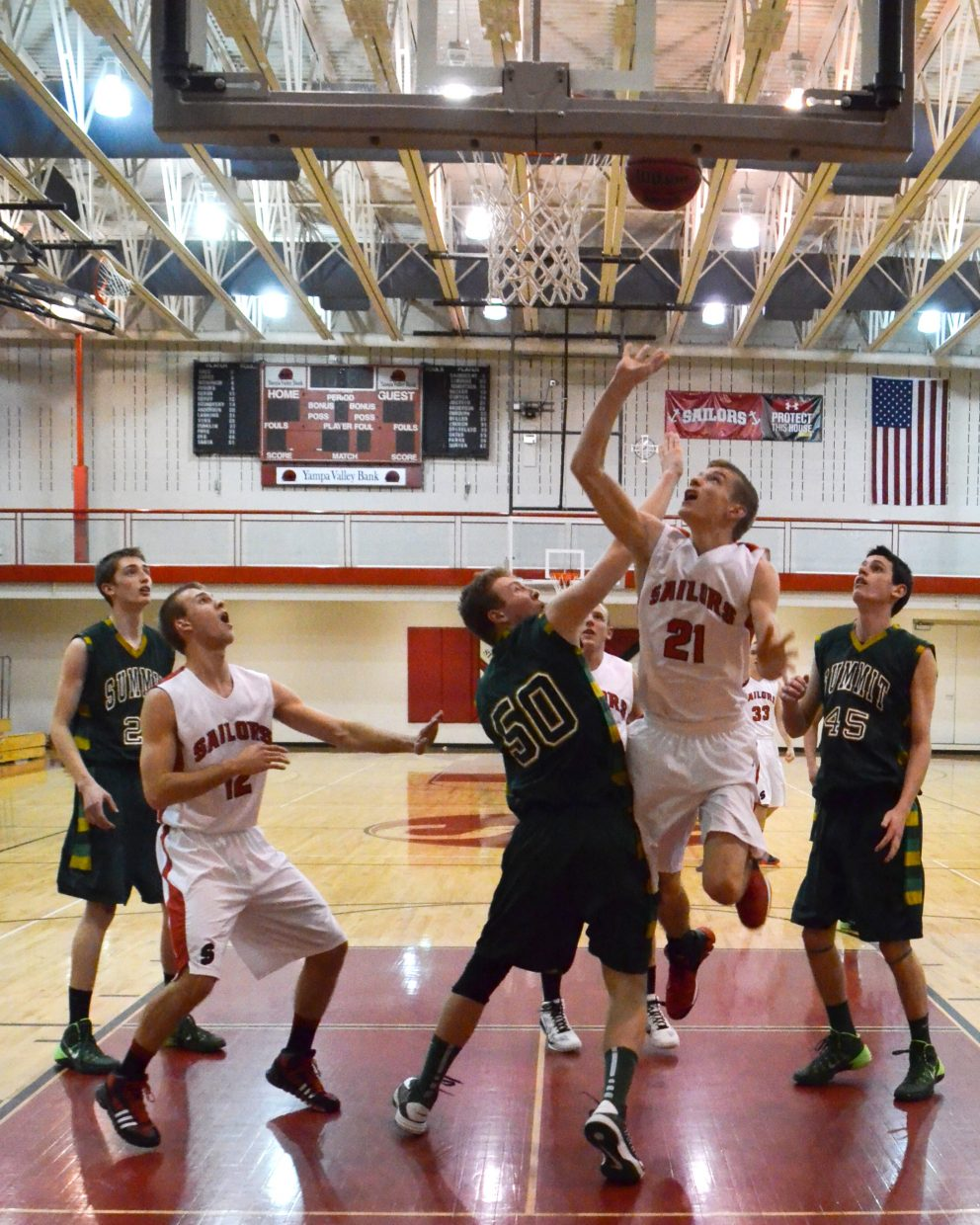 Steamboat Springs' Matthew Lanning drops in a layup off an assist from Nathan DePuy during the Sailors' game against Summit County on Tuesday night.