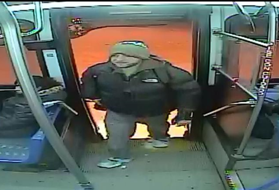 Surveillance photo of an unidentified subject who brandished a knife toward a passenger on a city bus Feb. 21.