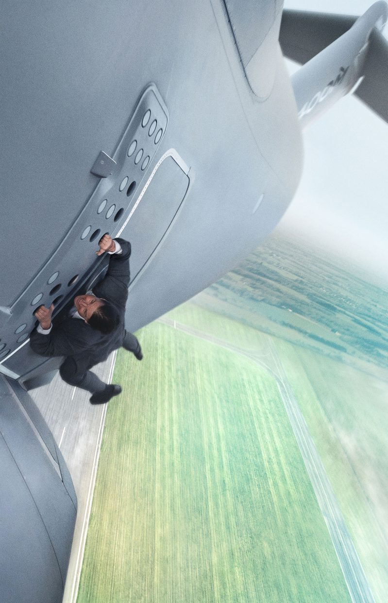 """IMF Agent Ethan Hunt (Tom Cruise) hangs on tight to the side of a plane during takeoff in """"Mission: Impossible — Rogue Nation."""" The movie is the fifth in the series about an organization tasked with pulling off intricate operations, this time meeting its match in an opposing worldwide group."""