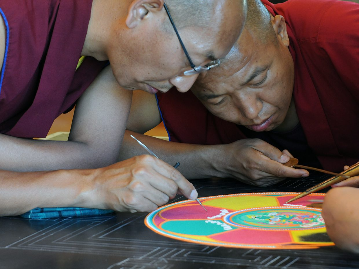 Drepung Loseling monks begin their mandala at the library. Submitted by Jeff Hall.