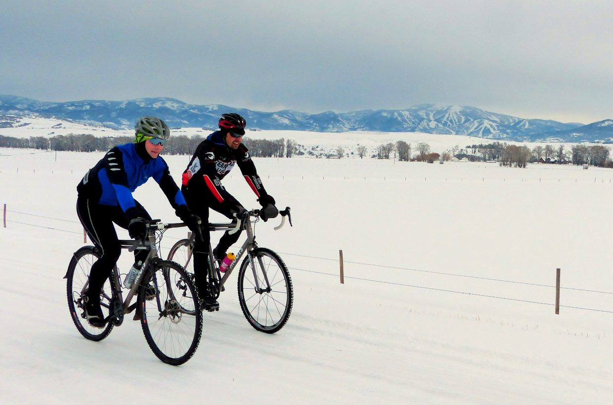Two hearty cyclists were riding the back roads in Routt County on Sunday, despite the cloudy skies and snow-covered roads. Submitted by: Shannon Lukens