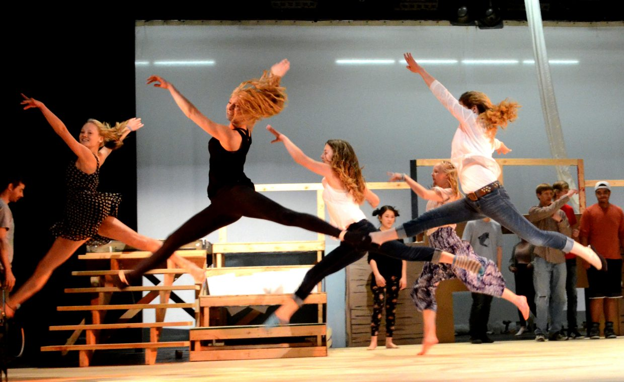 The musical's main dancers leap across the stage.